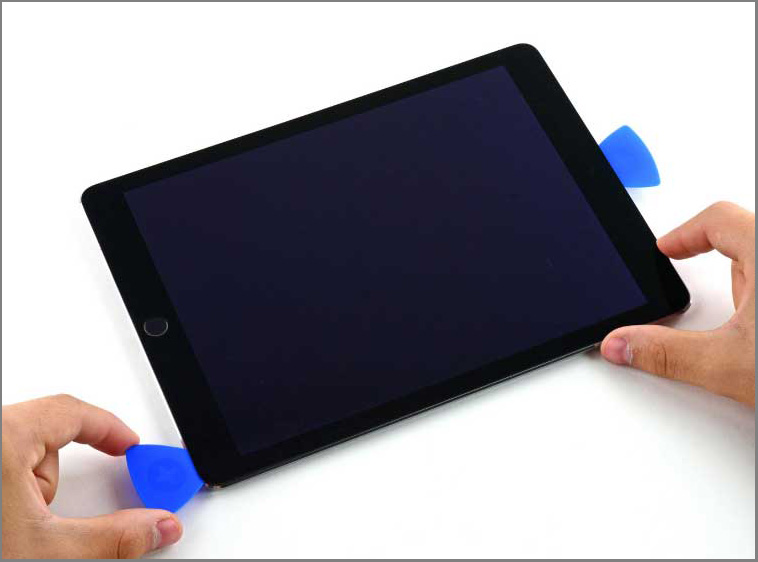 iPad air 2 screen replacement -25- Slide the left-hand opening pick along the bottom edge of the display, then remove it from the bottom right corner of the iPad